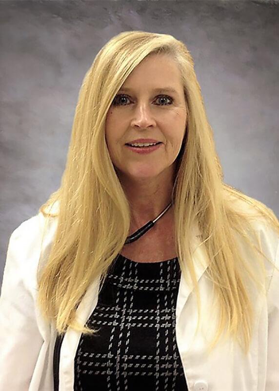 Brenda McCurdy, G.N.P.